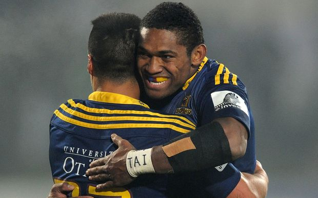 Waisake Naholo and Jason Emery of the Highlanders celebrate after defeating the Chiefs.