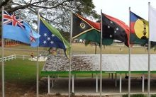 Flags of  Melanesian Spearhead Group member states. From left: flags of Fiji, Solomon Islands, Vanuatu, Papua New Guinea, FLNKS (New Caledonia's indigenous Kanak movement).