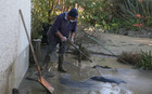 Whanganui resident Jimmy helps clear away mud from the back of his neighbour's property.