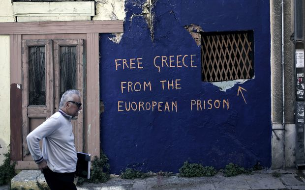 Anti-austerity graffiti on an abandoned house in Athens.