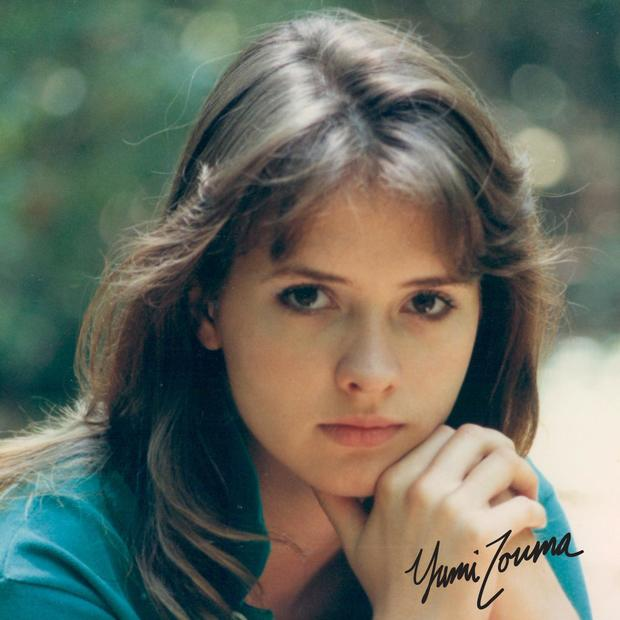 Yumi Zouma EP cover- Brunette young woman with great bangs, in 80s style, turquoise polo neck, in thoughtful pose.