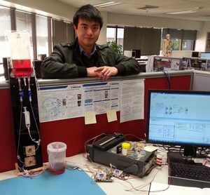 A photo of Dixon Leung with a prototype device to simulate a shunt and boost performance
