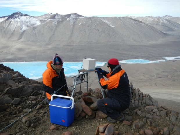 Waikato University's Craig Cary and Charles Lee installing a time lapse camera in Victoria Valley, one of the McMurdo Dry Valleys.