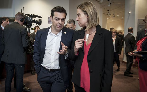 Greek Prime Minister Alexis Tsipras (L) and Federica Mogherini, EU High representative for foreign policy during the family picture at the European heads of state and governments summit at the EU Council headquarters in Brussels, Belgium.