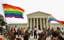 People celebrate in front of the US Supreme Court after the ruling in favor of same-sex marriage.
