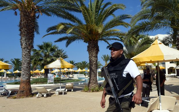 A Tunisian security member stands next to a swimming pool at the resort town of Sousse following the attack.