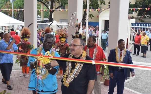 Solomon Islands Prime Minister Manasseh Sogavare and Peter O'Neill cut the ribbon to open the PNG Chancery