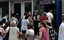 Greeks have been queuing to withdraw cash.