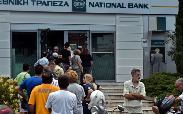 Greeks have been queuing to withdraw cash from banks.