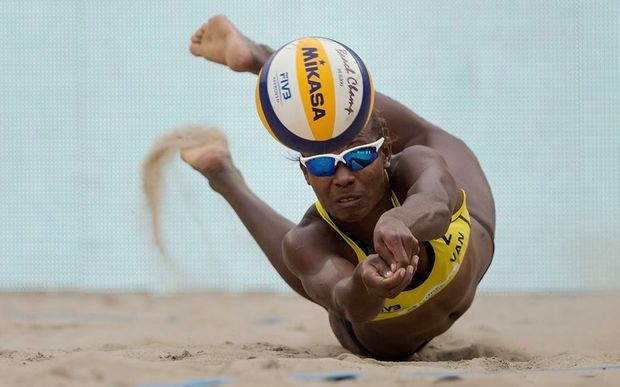 Vanuatu's Linline Matauatu in full flight against Brazil at the Beach Volleyball World Championships.
