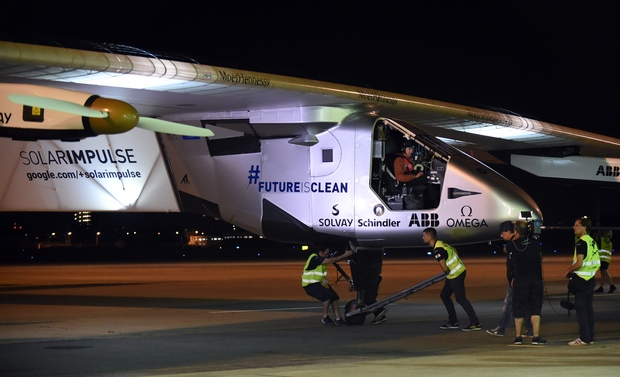 Pilot Andre Borschberg sits aboard Solar Impulse 2 prior to take-off from Nagoya's airport.