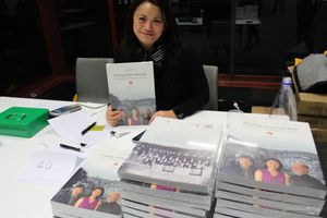 Justine Kohing selling copies at the launch
