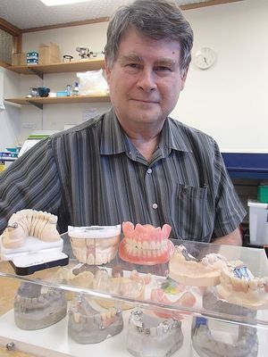 Dental technologist Neil Waddell says that making whole or partial dentures and replacement teeth is both an art and a science. Neil with range of dentures and dental devices.