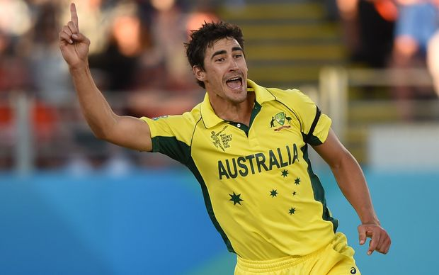 Mitchell Starc celebrating a wicket.