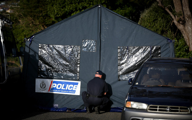 Police erect a forensic tent at the cordon down Broderick Crescent.