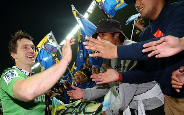 Ben Smith enjoys the adulation of Highlanders fans after their semi-final win over the NSW Waratahs.