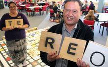 (from left) Kaihautu Māori Sheeanda Field with Senior Māori advisor Jacob Tapiata demonstrate the Māori scrabble game