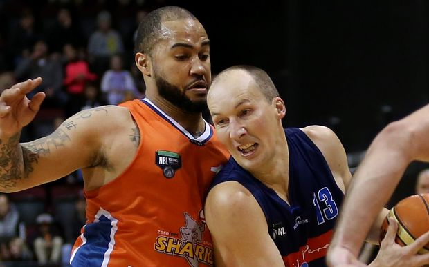 Phil Jones of the Giants drives passed Kevin Braswell of the Sharks during the NBL basketball match at Invercargill, June 13, 2015.