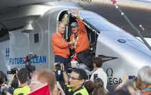 Solar Impulse 2 pilot Bertrand Piccard(L) and pilot Andre Borschberg, wave after Borschberg landed at Kalaeloa Airport, Hawaii.