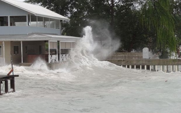 A Majuro business' shoreline bar and store is blasted by high waves kicked up by a tropical depression that was building to typhoon strength Friday night in the Marshall Islands. The waves caused major damage to the capital atoll's three-mile downtown lagoon shoreline.