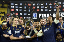 The Highlanders get their hands on the prize after winning the Super 15 competition for the first time.