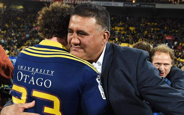 Jamie Joseph embraces Marty Banks after winning the Super Rugby title.