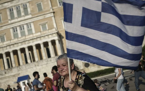 A woman outside the Greek parliament during a demonstration supporting the NO vote.
