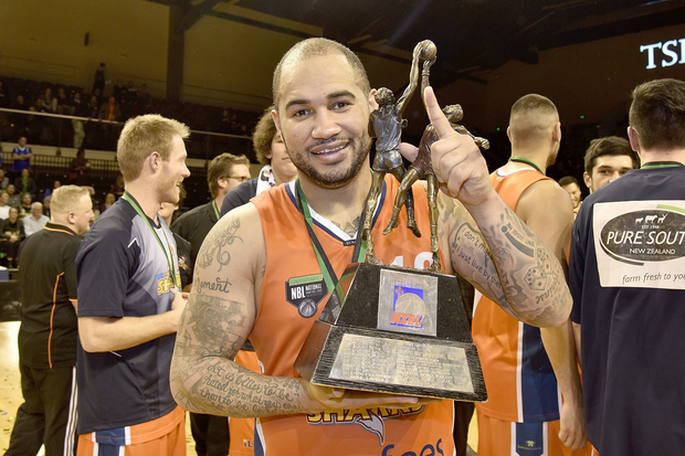 Kevin Braswell captain of the Southland Sharks holds the NBL trophy after winning the final.