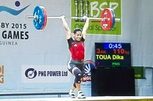 Papua New Guinea's Dika Toua wins weightlifting gold at the Pacific Games.