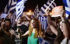 People celebrate in Athens after the first exit-polls of the Greek referendum.
