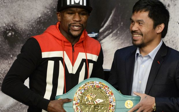 Floyd Mayweather Jnr and Manny Pacquiao pose with the WBO welterweight belt before their fight in April.