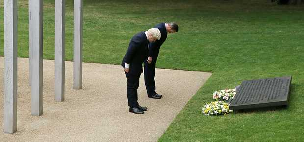 British Prime Minister David Cameron, right, and London Mayor Boris Johnson lay wreaths in London's Hyde Park in memory of the 52 victims of the 7/7 London attacks.