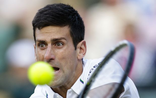 Top seed Novak Djokovic in action against 14th seed Kevin Anderson at Wimbledon, 2015.