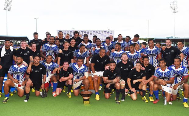 All Blacks and Samoa after New Zealand's victory at Apia Park.