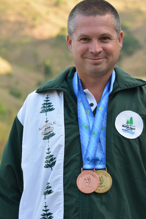 Douglas Creek from Norfolk Island shot his way to a gold winning performance in the mixed 25m air pistol competition.