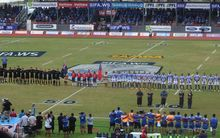 Manu Samoa and the All Blacks sing their respective national anthems at the stadium ahead of their rugby match in Apia