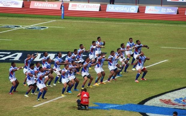 Manu Samoa rugby team performs the siva tau ahead of their match against the All Blacks in Apia