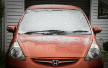 Snow slowly melts off a car in Karori.