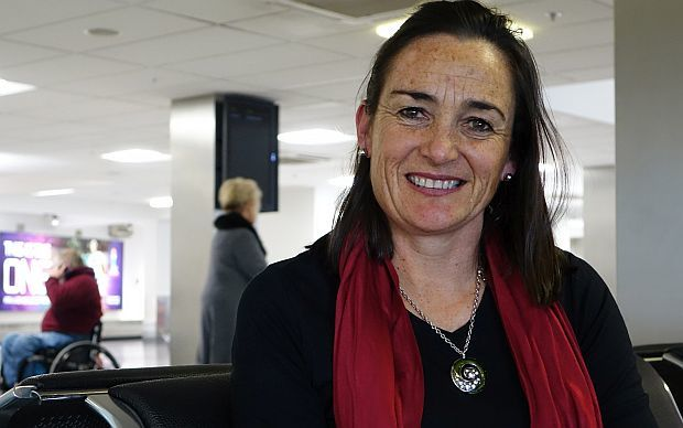 Agri consultant Alison Dewes sits at Auckland domestic airport