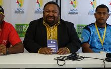 PNG Rugby League Chair Sandis Taska in the middle