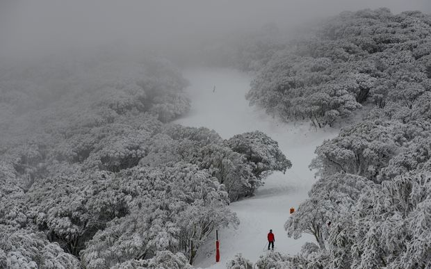 Skiers enjoy the wintery weather as snow blankets Falls Creek ski field, north of Melbourne.