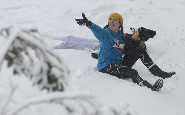 Tourists enjoy the snow at Falls Creek ski field, north of Melbourne.