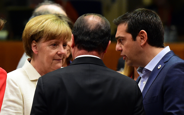 German Chancellor Angela Merkel, French President Francois Hollande (centre) and Greek Prime Minister Alexis Tsipras confer prior to the start of the summit in Brussels.