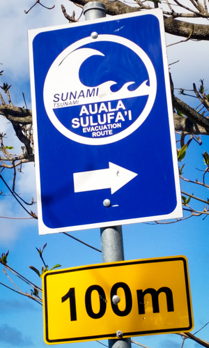 A sign on the beach directs people to the tsunami escape route.