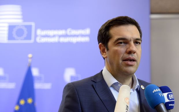 Greek Prime Minister Alexis Tsipras talks to the media at the end of an Eurozone Summit over the Greek debt crisis in Brussels on July 13, 2015.