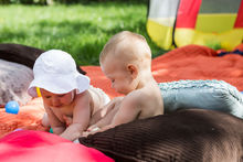 babies playing together (stock photo)