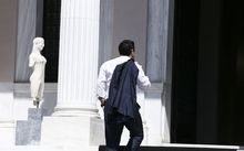 Greece's Prime Minister, Alexis Tsipras arrives at Maximos Mansion to attend a cabinet meeting.