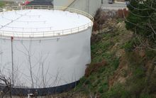 The Lyttelton oil tank that leaked after being hit by a landslide.