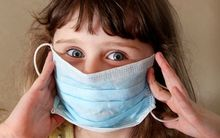 Child wearing flu mask