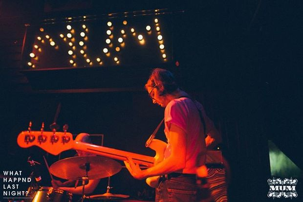 Bassist of The Shocking Pinks performing at MUM Club night